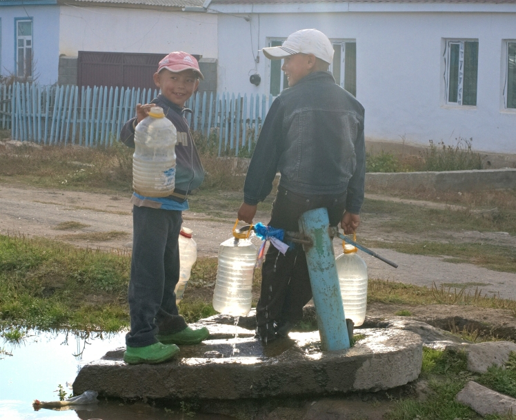 Young boys from Tamga collecting water